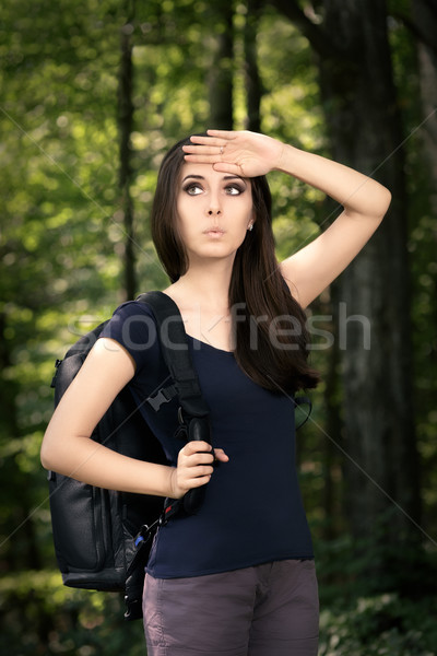Disoriented Hiking Girl with Travel Backpack  Stock photo © NicoletaIonescu