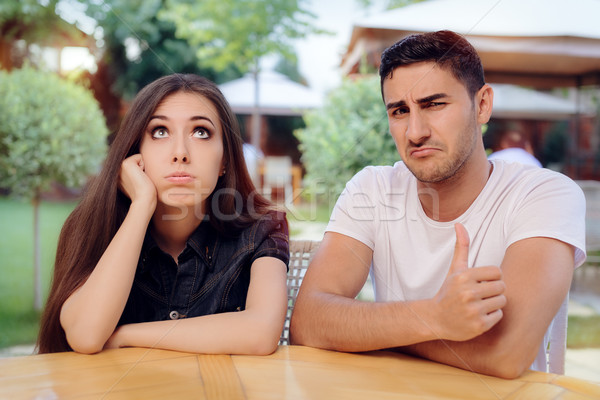 Woman and Man on a Boring Bad Date at the Restaurant Stock photo © NicoletaIonescu