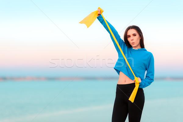 Grappig meisje werk uit yoga band Stockfoto © NicoletaIonescu
