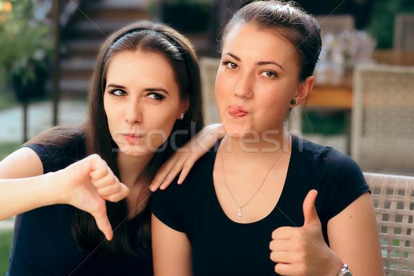 Komik kızlar başparmak aşağı farklı Stok fotoğraf © NicoletaIonescu