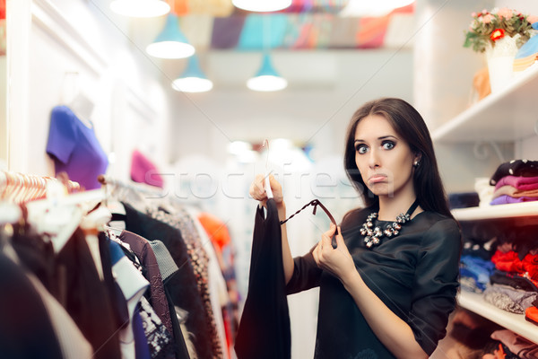 Woman Checking Price Tag on Sale in Clothing Store Stock photo © NicoletaIonescu