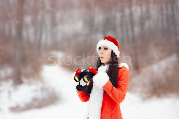 Surprised Girl with Binoculars Looking for Christmas  Stock photo © NicoletaIonescu