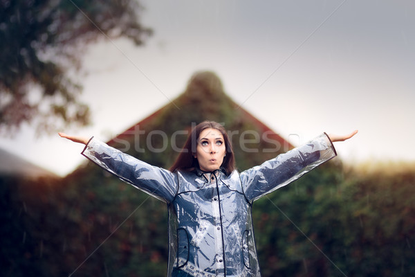 Cute Girl in Her Raising her Hands to Feel the Rain Stock photo © NicoletaIonescu