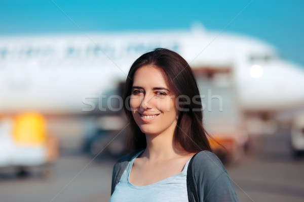 Happy Woman Ready to Board Airplane Stock photo © NicoletaIonescu