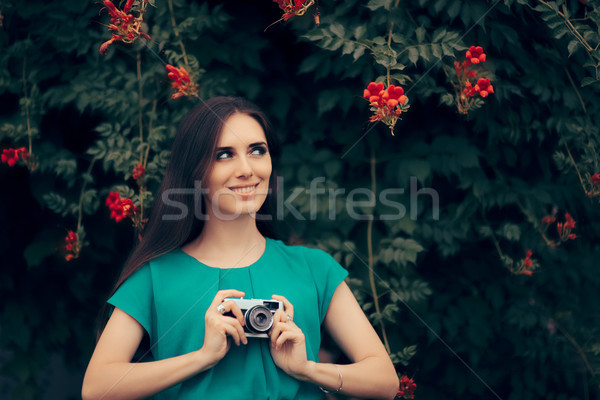 Happy Woman with Vintage Camera at a Garden Party Event Stock photo © NicoletaIonescu