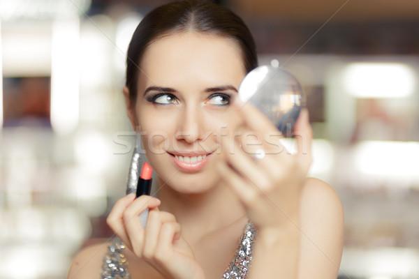 Glamour donna rossetto trucco specchio bella Foto d'archivio © NicoletaIonescu