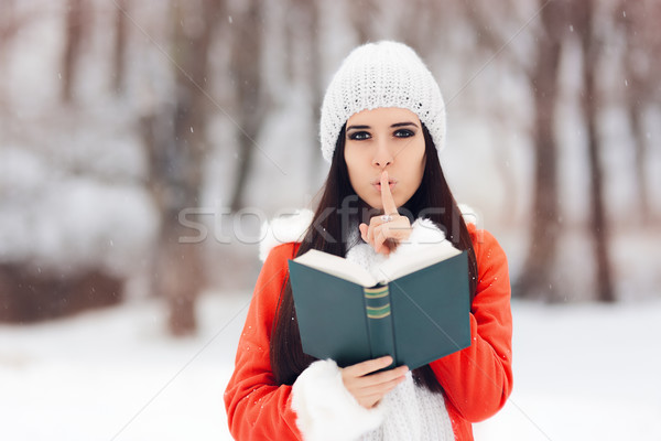 Winter Woman with Finger on Her Lips Holding a Book Stock photo © NicoletaIonescu