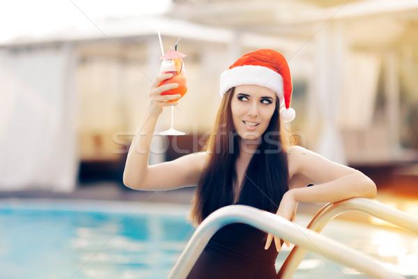 Flörtölő karácsony nő koktél medence vonzó lány Stock fotó © NicoletaIonescu