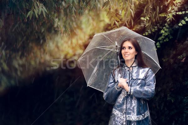 счастливым женщину плащ прозрачный зонтик оптимистичный Сток-фото © NicoletaIonescu