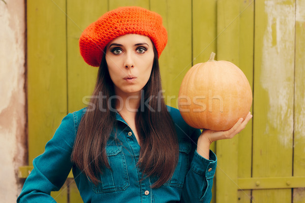 Surprised Autumn Woman Holding Pumpkin  Stock photo © NicoletaIonescu