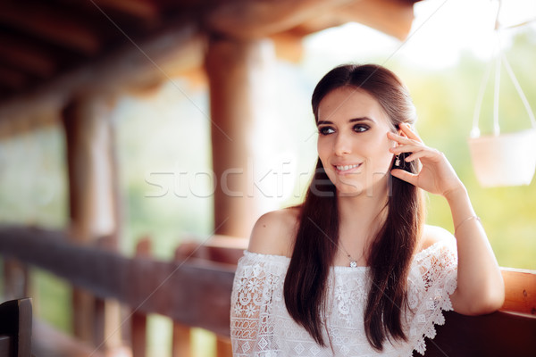 Portrait of a Smiling Woman Wearing White Lace Top Stock photo © NicoletaIonescu