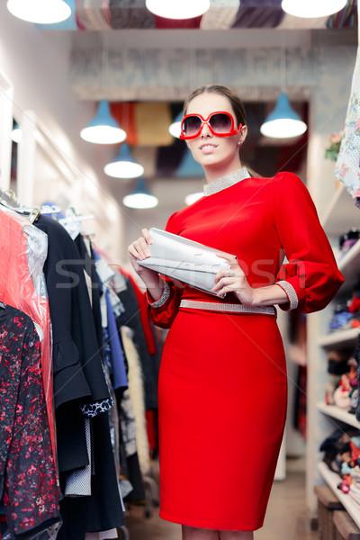 Nő visel vörös ruha divat bolt hölgy Stock fotó © NicoletaIonescu