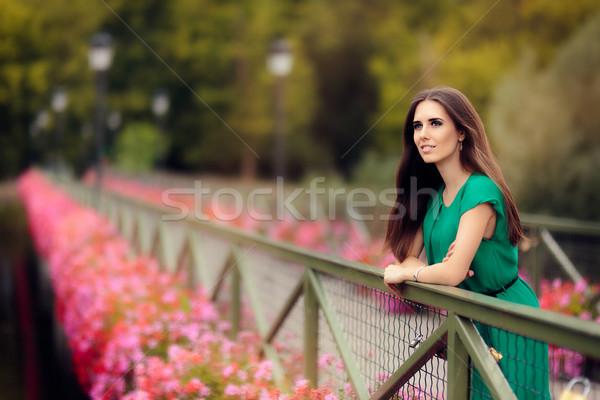счастливым меланхолический женщину моста цветы портрет Сток-фото © NicoletaIonescu