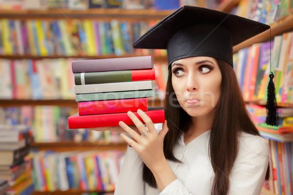 Engraçado estudante graduação boné livros Foto stock © NicoletaIonescu
