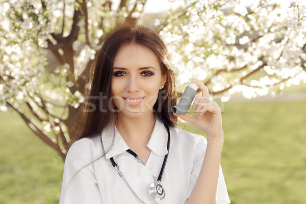 Spring Woman Doctor Smiling and Holding Inhaler Stock photo © NicoletaIonescu