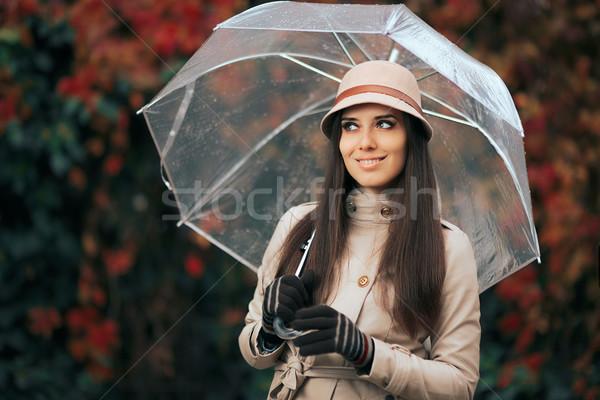 Happy Woman with Clear Plastic Transparent Umbrella in Autumn Rain Stock photo © NicoletaIonescu