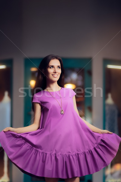 Girl in Purple Ruffled Dress in Front of Fashion Store Stock photo © NicoletaIonescu