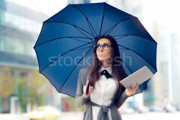 Disappointed  Woman with Glasses, Tablet and Umbrella Out in the City Stock photo © NicoletaIonescu