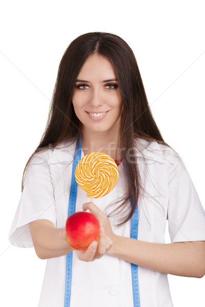 Nutritionist Choosing an Apple over a Lollipop Stock photo © NicoletaIonescu