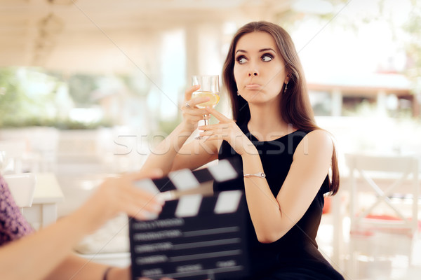 Upset Actress Holding a Glass in Movie Scene Stock photo © NicoletaIonescu