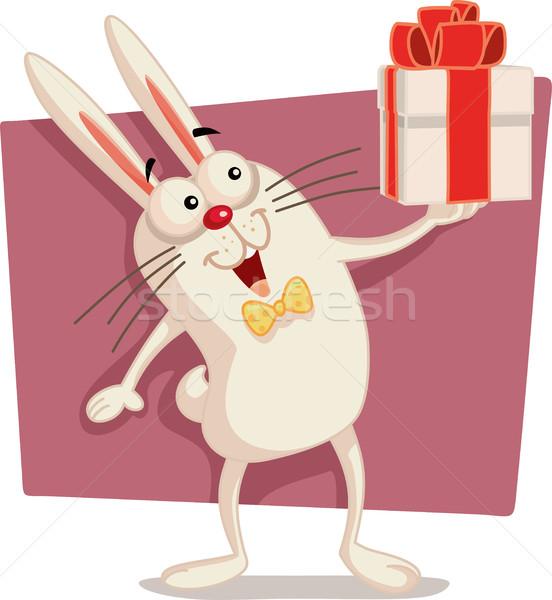 Happy Easter Bunny Holding Gift Box Vector Cartoon Stock photo © NicoletaIonescu