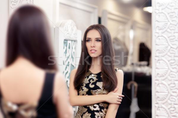 Hermosa niña mirando espejo elegante vestido retrato Foto stock © NicoletaIonescu