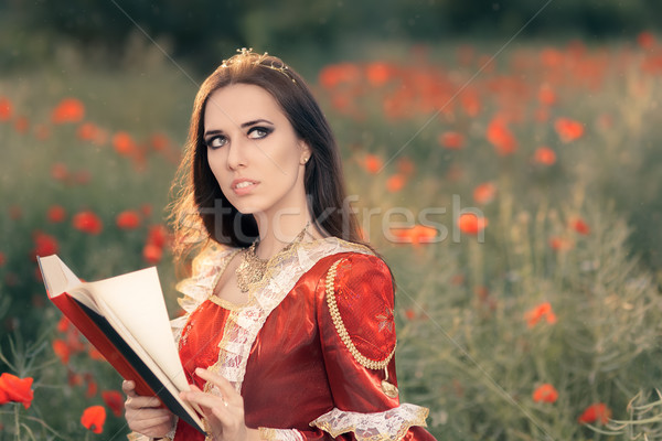 Beautiful Princess Reading a Book in Summer Floral Landscape   Stock photo © NicoletaIonescu