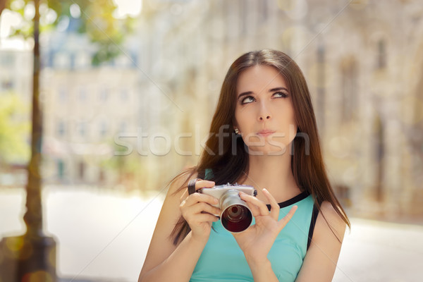 Undecided Girl with Compact Digital Camera Stock photo © NicoletaIonescu