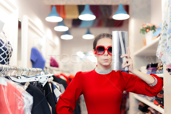 Funny fashion woman in red dress with big glasses and shinny bag Stock photo © NicoletaIonescu