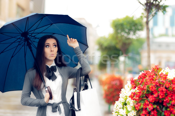 Woman Looking for a Taxi in Rainy Weather Stock photo © NicoletaIonescu