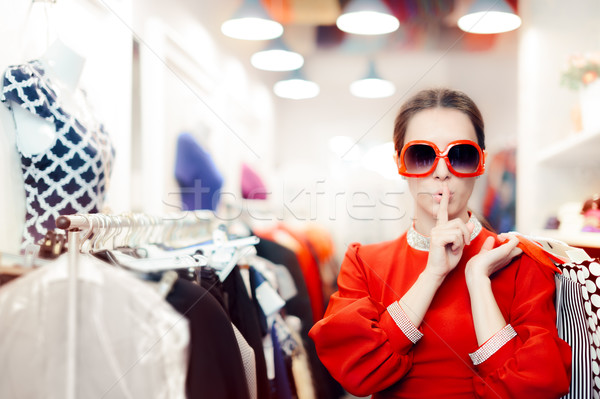 Shopping with Big Sunglasses Woman Keeping a Secret Stock photo © NicoletaIonescu
