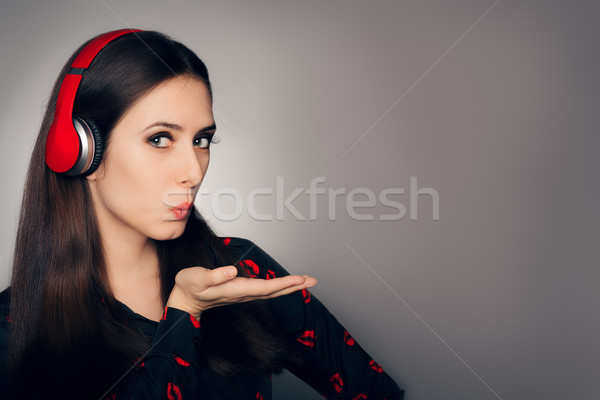 Girl with Headphones Blowing Kisses Stock photo © NicoletaIonescu