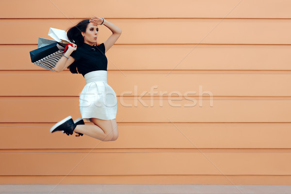 Surprised Woman Running With Shopping Bags in Summer Sale Season Stock photo © NicoletaIonescu