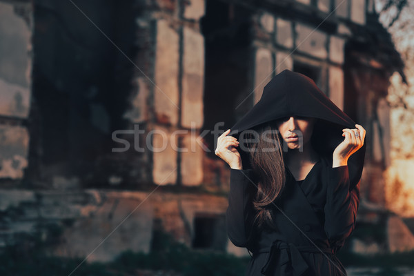Mysterious Evil Spirit in Front of a Horror Abandoned House Stock photo © NicoletaIonescu