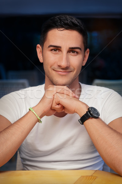 Young Man Sitting in a Restaurant Stock photo © NicoletaIonescu
