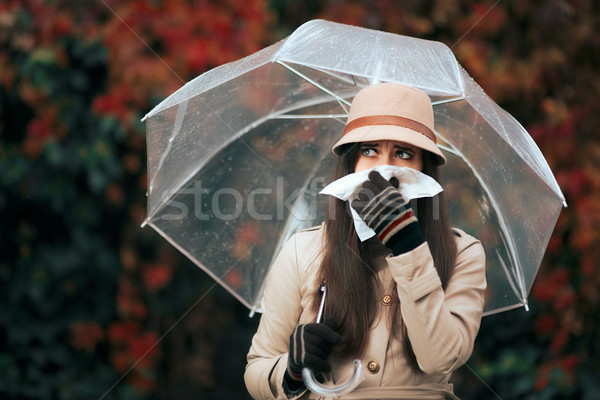 Sick Woman Holding  Umbrella in Autumn Rain Blowing Her Nose Stock photo © NicoletaIonescu