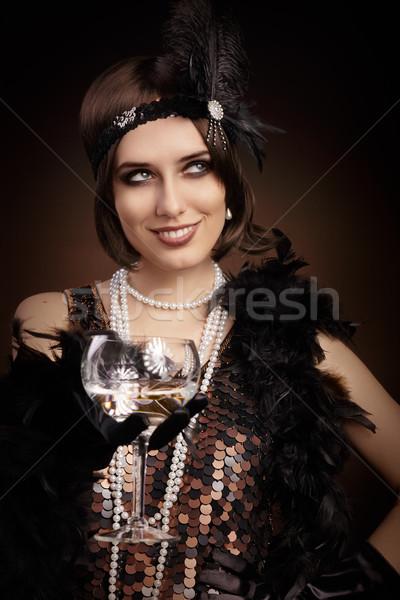 Retro 20s stijl vrouw champagne Stockfoto © NicoletaIonescu