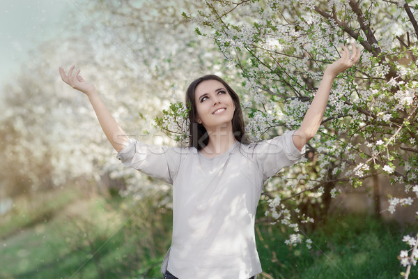 Happy Beautiful Girl in Spring Flowers Landscape  Stock photo © NicoletaIonescu