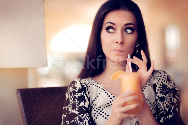 Surprised Woman With Orange Juice in a Restaurant Stock photo © NicoletaIonescu