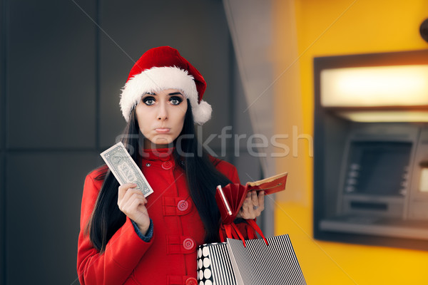 Christmas Woman Holding One Dollar in Front of an ATM  Stock photo © NicoletaIonescu