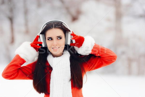 Boldog tél nő drótnélküli fejhallgató gyönyörű lány Stock fotó © NicoletaIonescu