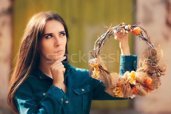 Surprised Girl Holding Decorative Autumn Wreath Stock photo © NicoletaIonescu