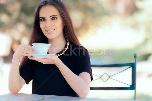 Beautiful Woman with Statement Necklace Having a Cup of Coffee  Stock photo © NicoletaIonescu