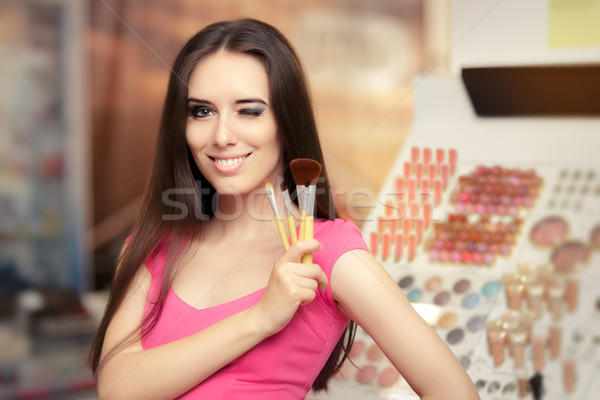Happy Girl Holding a Make-up Brush Stock photo © NicoletaIonescu