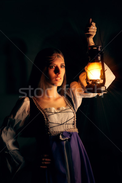 Beautiful Medieval Princess Holding Lantern  Stock photo © NicoletaIonescu
