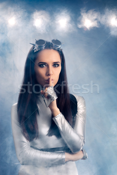 Space Woman in Silver Costume Holding a Secret Stock photo © NicoletaIonescu