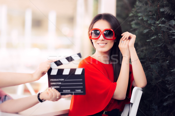 Happy Actress with Oversized Sunglasses Shooting Movie Scene Stock photo © NicoletaIonescu