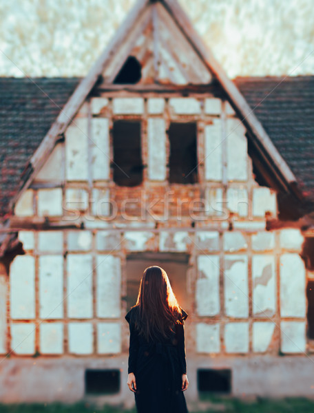 Evil Ghost in Front of a Horror Haunted Abandoned House Stock photo © NicoletaIonescu