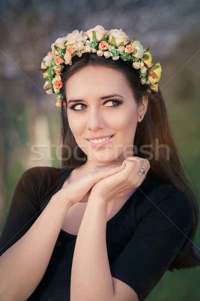 Portrait of a Happy Girl with Floral Wreath Outside Stock photo © NicoletaIonescu