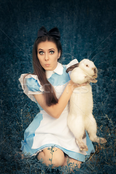 Funny Girl Costumed as Alice in Wonderland with The White Rabbit Stock photo © NicoletaIonescu